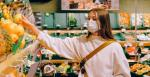 Woman wearing fabric mask in supermarket